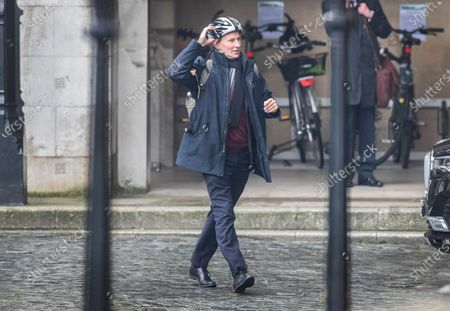 Former Foreign Secretary Jeremy Hunt loosens his cycle helmet as he arrives at Parliament ahead of Prime Minister's Questions.