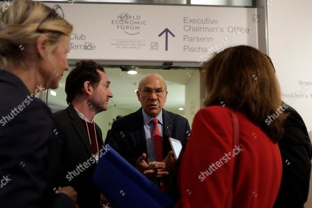 Organization for Economic Cooperation and Development (OECD) Secretary-General Angel Gurria, center, attends the World Economic Forum in Davos, Switzerland, . The 50th annual meeting of the forum is taking place in Davos from Jan. 21 until Jan. 24, 2020