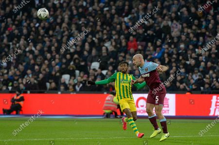 Pablo Zabaleta of West Ham United and  Kyle Edwards of West Bromwich Albion in action during the FA Cup Fourth Round match between West Ham United and West Bromwich Albion at the London Stadium in London, UK - 25th January 2020