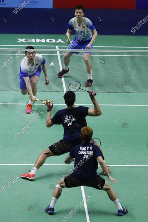 China's Huang Kai Xiang and Liu Cheng (top L) in action against Taipei's Lu Ching Yao and Yang Po Han during their men's doubles match of the Badminton Princess Sirivannavari Thailand Masters 2020 in Bangkok, Thailand, 23 January 2020.