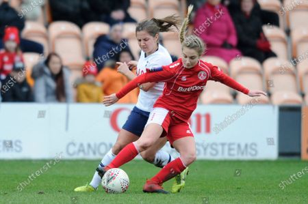 Stock Photo of Kit Graham of Tottenham Hotspur Women and Darcie Greene of Barnsley Women in action during the WomenÕs FA Cup Fourth Round match between Tottenham Hotspur Women and Barnsley Women at The Hive Stadium in London, UK - 26th January 2020