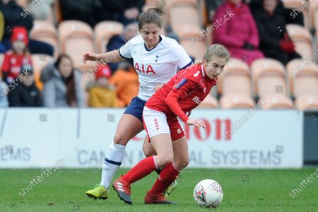 Stock Image of Kit Graham of Tottenham Hotspur Women and Darcie Greene of Barnsley Women in action during the WomenÕs FA Cup Fourth Round match between Tottenham Hotspur Women and Barnsley Women at The Hive Stadium in London, UK - 26th January 2020