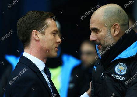 Fulham manager Scott Parker with counterpart Pep Guardiola of Manchester City