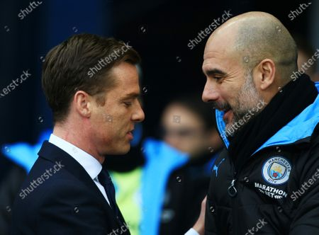 Stock Image of Fulham manager Scott Parker with counterpart Pep Guardiola of Manchester City