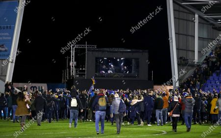 Shrewsbury Town fans invade the pitch at full time and head for the BBC studio where Gary Lineker, Joe Hart and Ian Wright are working