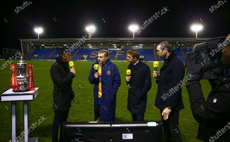 Stock Photo of Jason Cummings of Shrewsbury Town is interviewed for BBC Sport alongside presenter Manish Bhasin and pundits Stephen Warnock and Martin Keown