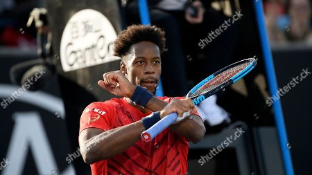 France's Gael Monfils celebrates after defeating Croatia's Ivo Karlovic in their second round singles match at the Australian Open tennis championship in Melbourne, Australia