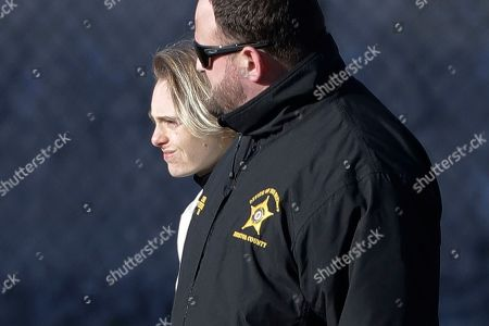 Michelle Carter, left, leaves the Bristol County jail, in Dartmouth, Mass., after serving most of a 15-month manslaughter sentence for urging her suicidal boyfriend to kill himself in 2014. The 23-year-old, released three months early for good behavior, will serve five years of probation