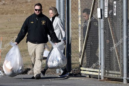 Stock Photo of Michelle Carter, center, leaves the Bristol County jail, in Dartmouth, Mass., after serving most of a 15-month manslaughter sentence for urging her suicidal boyfriend to kill himself in 2014. The 23-year-old, released three months early for good behavior, will serve five years of probation