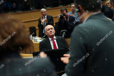 British European Parliament member Richard Corbett is applaud by other European Parliament members during an European Parliament's constitutional affairs committee meeting for Brexit at the European Parliament in Brussels