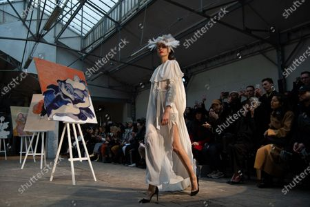 Stock Image of A model presents a creation from the Spring/Summer 2020 Haute Couture collection by Dutch-Vietnamese designer Xuan-Thu Nguyen for her label Xuan during the Paris Fashion Week, in Paris, France, 23 January 2020. The presentation of the Haute Couture collections runs from 20 to 23 January.