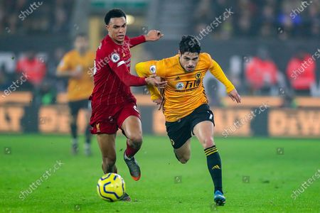 Liverpool defender Trent Alexander-Arnold (66) tries to hold Wolverhampton Wanderers midfielder Pedro Neto (7) during the Premier League match between Wolverhampton Wanderers and Liverpool at Molineux, Wolverhampton