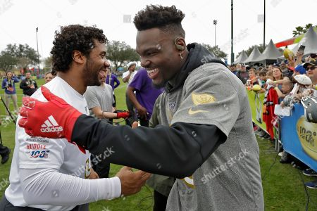 Shaquil Barrett, Russell Wilson. NFC linebacker Shaquil Barrett, of the Tampa Bay Buccaneers, right, shakes hands with quarterback Russell Wilson, of the Seattle Seahawks, after a practice for the NFL Pro Bowl football game, in Kissimmee, Fla