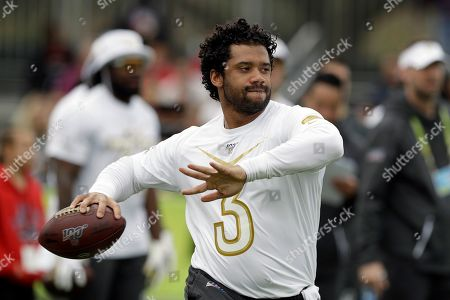 NFC quarterback Russell Wilson, of the Seattle Seahawks, fires a pass during a practice for the NFL Pro Bowl football game, in Kissimmee, Fla