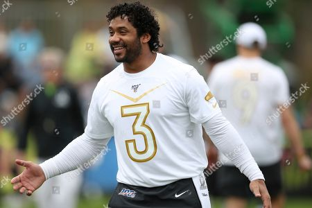 NFC quarterback Russell Wilson, of the Seattle Seahawks, reacts during Pro Bowl NFL football practice, in Kissimmee, Fla