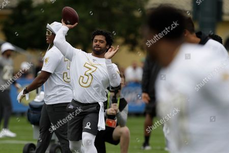 NFC quarterback Russell Wilson, of the Seattle Seahawks, (3) throws a pass during a practice for the NFL Pro Bowl football game, in Kissimmee, Fla