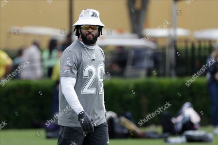AFC free safety Earl Thomas, of the Baltimore Ravens, walks the field during a practice for the NFL Pro Bowl football game, in Kissimmee, Fla