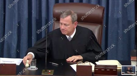 In this image from United States Senate television, Chief Justice of the United States John G Roberts Jnr, Jr. grants the request for a break during the impeachment trial of US President Donald J. Trump in the US Senate