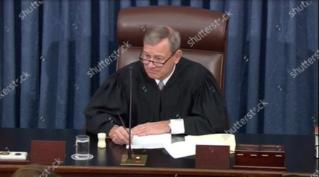 In this image from United States Senate television, Chief Justice of the United States John G Roberts Jnr, Jr. presides prior to US Representative Hakeem Jeffries (Democrat of New York)making part of the Democratic presentation at the impeachment trial of US President Donald J. Trump in the US Senate