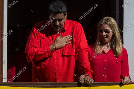 President of Venezuela, Nicolas Maduro (L), speaks along with his wife Cilia Flores (R) at the end of a march through the streets of Caracas, Venezuela, 23 January 2020. Venezuela commemorates 62 years of the fall of the dictatorship of Marcos Perez Jimenez, amid the political dispute between the leadership of the ruling party and the opposition that do not recognize each other. The Chavista government organized an 'anti-imperialist march' in western Caracas with which it hopes to reach the Miraflores Palace, the seat of the Executive. It is, according to the ruling leaders, a demonstration 'against treason against the people', in reference to the democratic governments that settled in Venezuela from 1958 until the so-called Bolivarian revolution came to power in 1999.