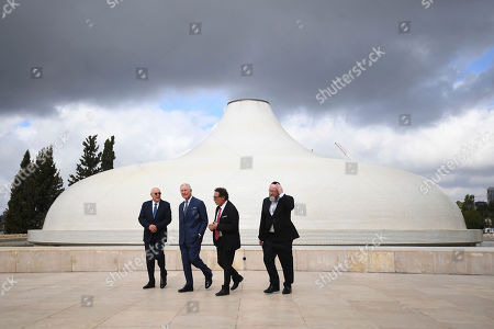 Britain's Prince Charles, second left, and Chief Rabbi Ephraim Mirvis, right, visit the Shrine of the Book at the Israel Museum in Jerusalem, . Prince Charles is among dozens of presidents, heads of state and dignitaries who have descended upon the city to attend the largest-ever gathering focused on commemorating the Holocaust and combating modern-day anti-Semitism