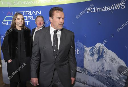 Actor and former Governor of the State of California (US) Arnold Schwarzenegger (R) joined by his daughter Christina (L) and former Austrian Alpine ski racer Franz Klammer (C) arrive for a charity dinner he is hosting to draw more attention to the important issue of climate protection and innovation in Kitzbuehel, Austria, 23 January 2020.