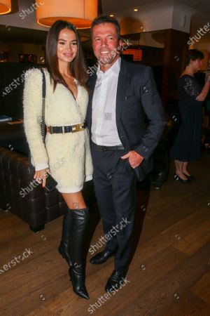 Stock Picture of Lothar Matthaus and Anastasia Klimko at the charity dinner and auction for the Schwarzenegger Climate Initiative at the Kitzbuehel Country Club