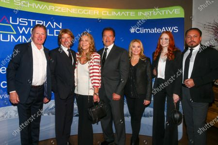 Franz Klammer, Hansi Hinterseer and Romana Hinterseer, Arnold Schwarzenegger, Heather Milligan, Barbara Meier and Klemens Hallmann at the charity dinner and auction for the Schwarzenegger Climate Initiative, at the Kitzbuehel Country Club