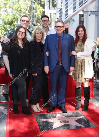 Sir Lucian Grainge and family