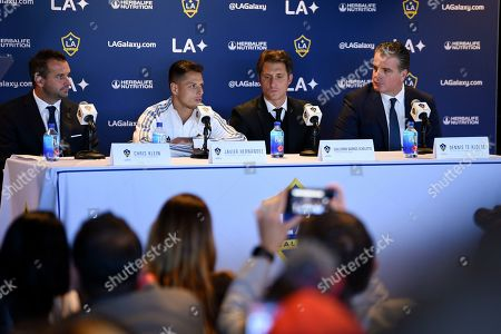 """Stock Picture of Los Angeles Galaxy's Javier """"Chicharito"""" Hernández, second from left, is introduced during a press conference with head coach Guillermo Barros Schelott, second from right, general manager Dennis te Kloese, right, and president Chris Klein in Carson, Calif"""
