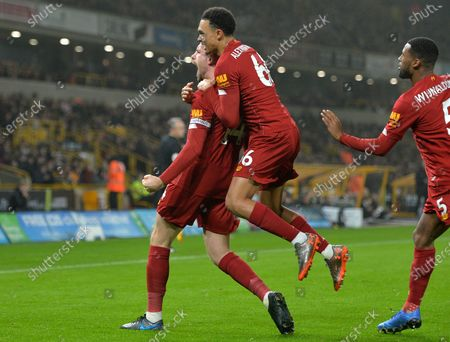 Liverpool's  Jordan Henderson (L) reacts after scoring the 1-0 lead with Trent Alexander-Arnold (C) and Georginio Wijnaldum (R) during the English Premier League soccer match between Liverpool FC and Wolverhampton Wanderers FC held at Molineux Stadium in Wolverhampton, Britain, 23 January 2020.