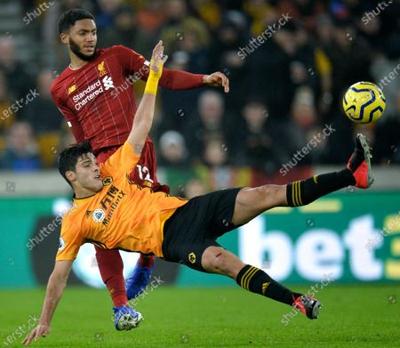 Wolverhampton Wanderers's Raul Jimenez (R) in action against Liverpool's Joe Gomez (L) during the English Premier League soccer match between Liverpool FC and Wolverhampton Wanderers FC held at Molineux Stadium in Wolverhampton, Britain, 23 January 2020.