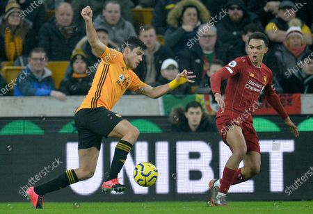 Wolverhampton Wanderers's Raul Jimenez (L) in action against Liverpool's Trent Alexander-Arnold (R) during the English Premier League soccer match between Liverpool FC and Wolverhampton Wanderers FC held at Molineux Stadium in Wolverhampton, Britain, 23 January 2020.