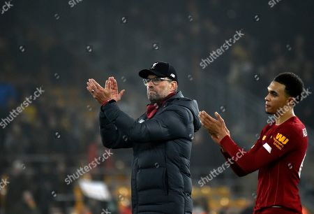 Liverpool's manager Jurgen Klopp, left, and Liverpool's Trent Alexander-Arnold greet supporters at the end of the English Premier League soccer match between Wolverhampton Wanderers and Liverpool at the Molineux Stadium in Wolverhampton, England