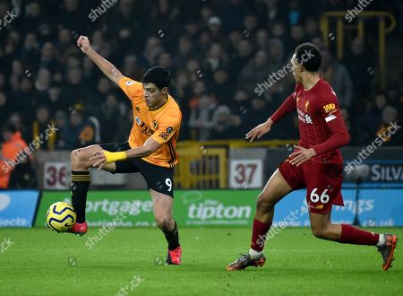 Wolverhampton Wanderers' Raul Jimenez, left, controls the ball by Liverpool's Trent Alexander-Arnold during the English Premier League soccer match between Wolverhampton Wanderers and Liverpool at the Molineux Stadium in Wolverhampton, England