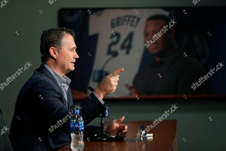 Stock Photo of With a photo of Seattle Mariners legend Ken Griffey Jr. in the background, manager Scott Servais speaks, in Seattle during the Seattle Mariners annual news conference before the start of Spring Training baseball