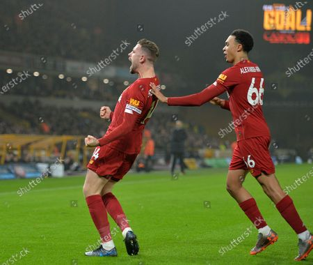 Liverpool's  Jordan Henderson (L) celebrates scoring the 1-0 lead with Trent Alexander-Arnold (R) during the English Premier League soccer match between Liverpool FC and Wolverhampton Wanderers FC held at Molineux Stadium in Wolverhampton, Britain, 23 January 2020.