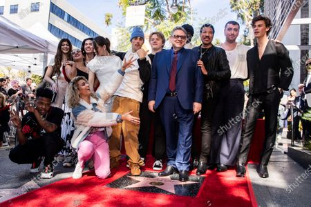 Universal Music Group CEO Sir Lucian Grainge (C) poses among some of his artists like Canadian singer Shawn Mendes, British singer Sam Smith, US singer Lionel Richie, US singer Gregory Porter (partly hidden), Scottish singer Lewis Capaldi, Canadian singer Justin Bieber, US actress Hailee Steinfeld and US singer Tori Kelly (front) after he was honored with the 2,685th star on the Hollywood Walk of Fame in Hollywood, California, USA, 23 January 2020. The star was dedicated in the category of Recording.