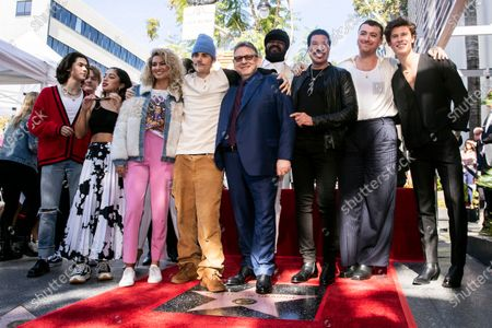 Universal Music Group CEO Sir Lucian Grainge (C) poses among some of his artists like Canadian singer Shawn Mendes, British singer Sam Smith, US singer Lionel Richie, US singer Gregory Porter, Canadian singer Justin Bieber, and US singer Tori Kelly after he was honored with the 2,685th star on the Hollywood Walk of Fame in Hollywood, California, USA, 23 January 2020. The star was dedicated in the category of Recording.