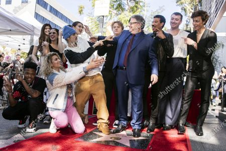 Universal Music Group CEO Sir Lucian Grainge (C) poses among some of his artists like Canadian singer Shawn Mendes, British singer Sam Smith, US singer Lionel Richie, Scottish singer Lewis Capaldi, US actress Hailee Steinfeld, Canadian singer Justin Bieber, and US singer Tori Kelly (front) after he was honored with the 2,685th star on the Hollywood Walk of Fame in Hollywood, California, USA, 23 January 2020. The star was dedicated in the category of Recording.