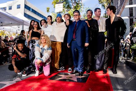 Universal Music Group CEO Sir Lucian Grainge (C) poses among some of his artists like Canadian singer Shawn Mendes, British singer Sam Smith, US singer Lionel Richie, Scottish singer Lewis Capaldi, Canadian singer Justin Bieber, US actress Hailee Steinfeld, and US singer Tori Kelly (front) after he was honored with the 2,685th star on the Hollywood Walk of Fame in Hollywood, California, USA, 23 January 2020. The star was dedicated in the category of Recording.