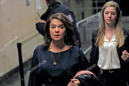 Actress Annabella Sciorra, left, leaves Manhattan Criminal Court after appearing at Harvey Weinstein's rape and sexual assault trial, in New York