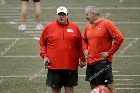 Kansas City Chiefs head coach Andy Reid and special teams coach David Toub watch an NFL football practice at in Kansas City, Mo. The Chiefs will face the San Francisco 49ers in Super Bowl 54