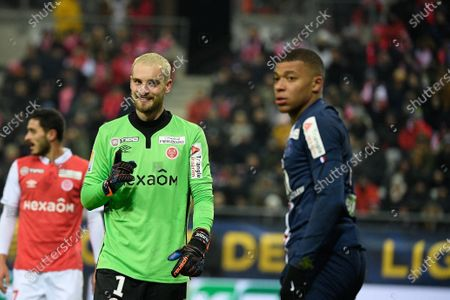 Kylian Mbappe of PSG and Predrag Rajkovic of Stade Reims