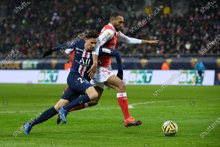 Julian Draxler of PSG and Yunis Abdelhamid of Stade Reims
