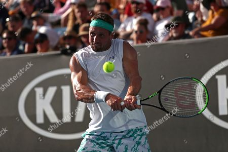Tennys Sandgren of the U.S. makes a backhand return to compatriot Sam Querrey in their third round singles match at the Australian Open tennis championship in Melbourne, Australia