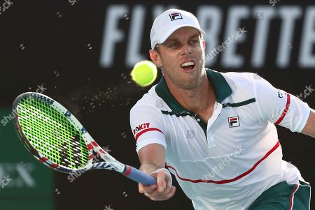 Sam Querrey of the U.S. makes a forehand return to compatriot Tennys Sandgren during their second round singles match at the Australian Open tennis championship in Melbourne, Australia