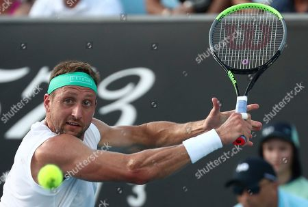 Tennys Sandgren of the U.S. makes a backhand return to compatriot Sam Querrey during their third round singles match at the Australian Open tennis championship in Melbourne, Australia