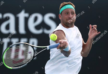 Tennys Sandgren of the U.S. makes a forehand return to compatriot Sam Querrey during their third round singles match at the Australian Open tennis championship in Melbourne, Australia