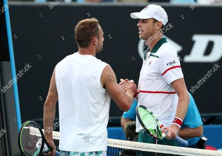 Tennys Sandgren, left, of the U.S. is congratulated by compatriot Sam Querrey after winning their third round singles match at the Australian Open tennis championship in Melbourne, Australia